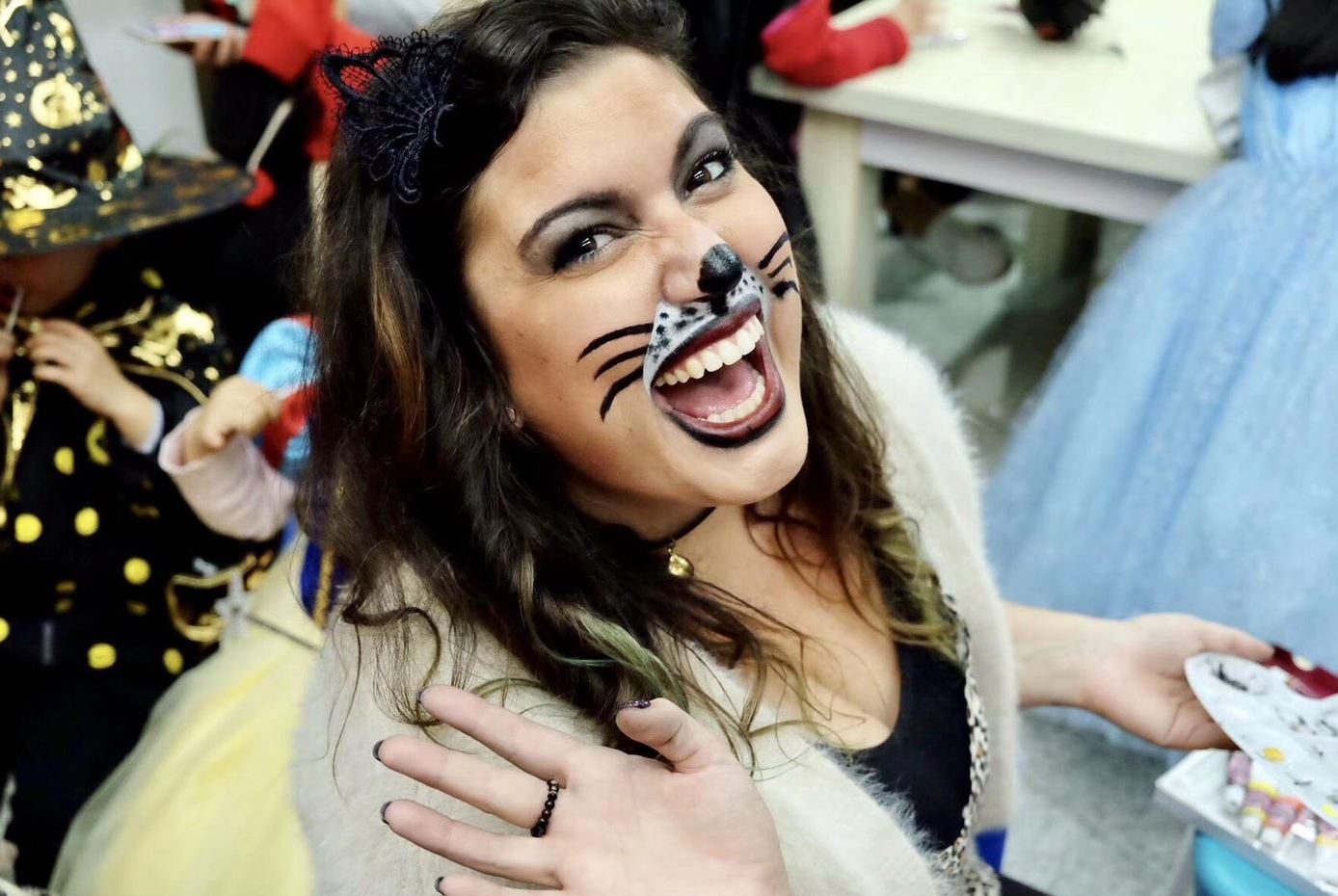 Ms. Annie Wall with her face painted like a cat