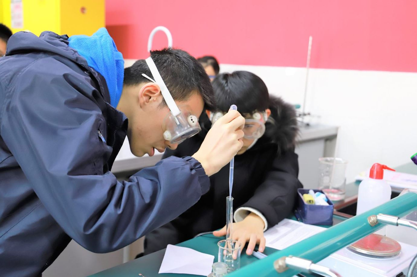 Chinese students Test Chemical Reactions in Chemistry Class