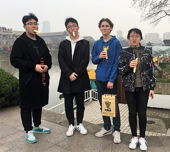 Exchange student Sam Guyer shopping in Natong with host family